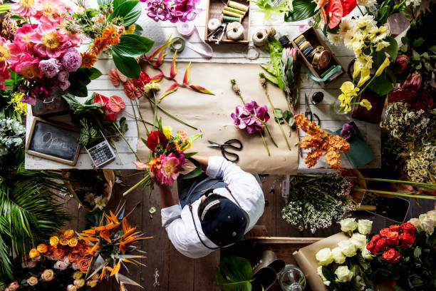 Florist working on flower arrangement among the flower